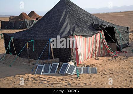 Portable solar panels electricity supply Sahara desert Morocco - Stock Photo