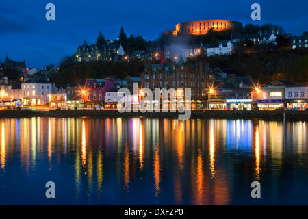 Oban at Night from Rail pier towards Town and McCaigs tower,Argyll December 2012 - Stock Photo