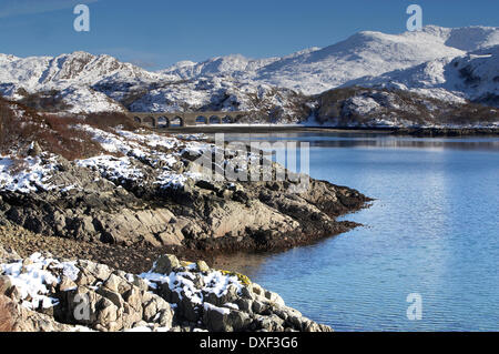 Winter view across Loch nan uamh towards the rail viaduct on the west highland line.West Highlands. - Stock Photo
