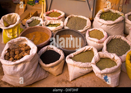 A display of spices and grains in open sacks outside a Berber shop in Morocco, north Africa. - Stock Photo