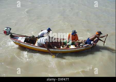 ALCANTARA, BRAZIL - OCTOBER 3, 2013: Brazilian fishermen travel in old-fashioned traditional fishing boat on milky - Stock Photo