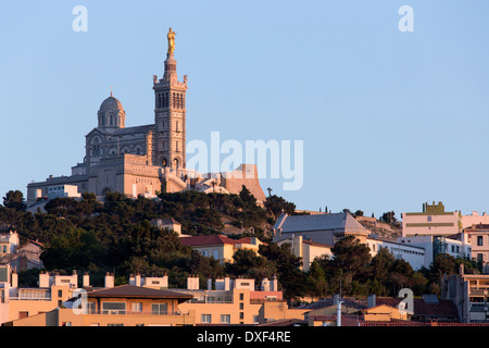 Late afternoon sunlight on the Cathedral de Notre-Dame-de-la-Garde high on a hill overlooking Marseille in the South - Stock Photo