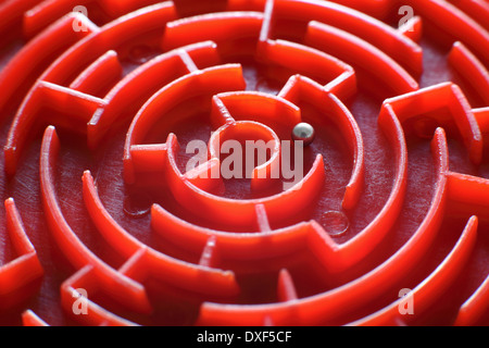 Close up of a small, toy maze. (This is the centre of a small, circular maze which is only 80mm in diameter). - Stock Photo