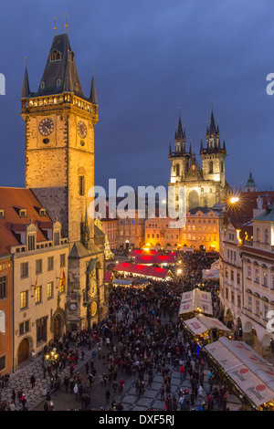 the Old Town Square at dusk, with the Old Town Hall and Church of Our Lady Before Tyn, Prague - Stock Photo
