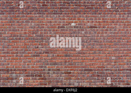Pocked and stained red brick wall; landscape orientation. - Stock Photo