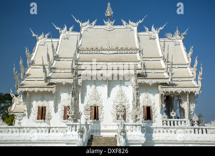 Famous Wat Rong Khun (White temple) in Chiang Rai province, Northern Thailand - Stock Photo