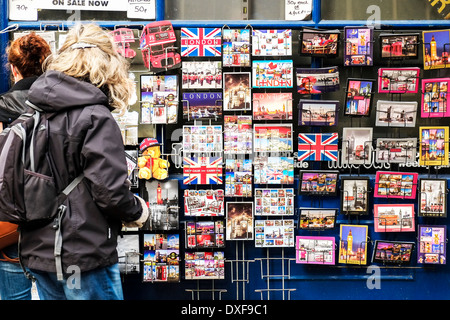 A display of souvenir postcards outside a shop in London. - Stock Photo