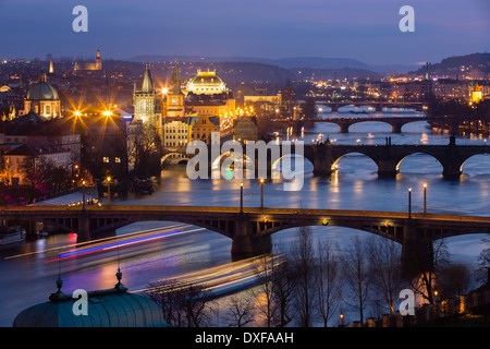 the Manes, Charles and Legion Bridges over the Vltava River at dusk, with the Old Town on the left, Prague, Czech Republic