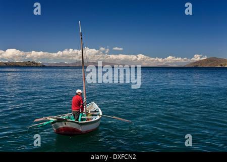 Fishing boat near Sun Island (Isla de Sol) on Lake Titicaca in Bolivia - Stock Photo