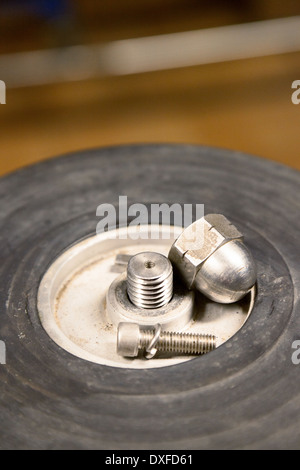Nuts and bolts on a factory machine machinery - Stock Photo