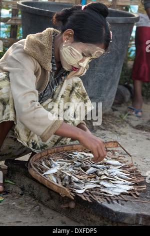 Burmese woman, near the fishing village on Ngapali Beach in Myanmar (Burma). - Stock Photo
