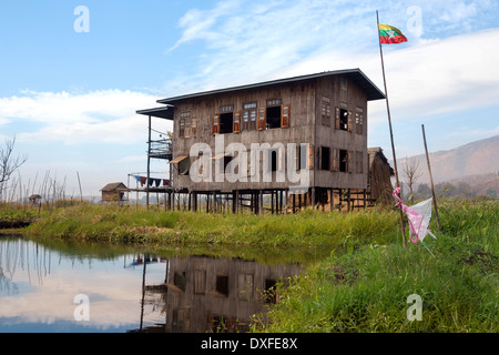 Farmhouse on a small island in the floating gardens of Inle Lake in Shan State in central Myanmar (Burma). - Stock Photo