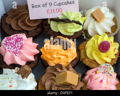 A box of 9 cup cakes for sale on a market stall in Yorkshire in the United Kingdom.