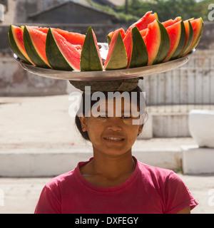 A Burmese woman selling watermelon at a temple in Bagan in Myanmar (Burma). - Stock Photo
