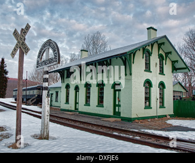 old train station and depot in winter - Stock Photo