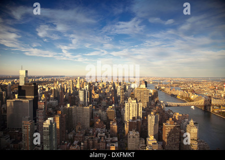 Elevated view of Manhattan at Mid-Town with East River and Queensboro Bridge at sunset. - Stock Photo