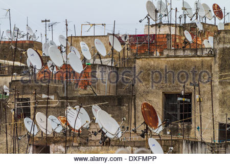 View of satellite dishes and television aerials on roof of houses - Morocco - Stock Photo