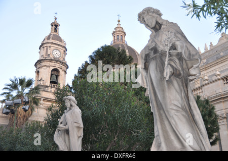 Catania Cathedral ( Duomo di Catania, Cattedrale di Sant'Agata) and statues in the foreground in Sant'Agata Gardens, - Stock Photo