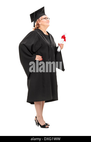 Full length portrait of a mature student holding a diploma - Stock Photo