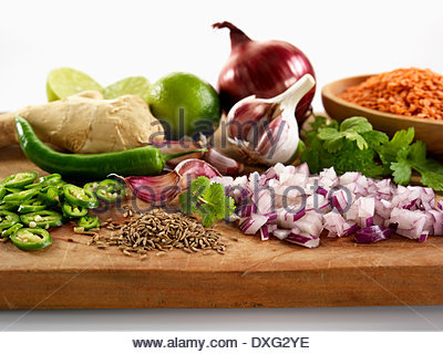 Ingredients For Indian Dahl On Wooden Board - Stock Photo