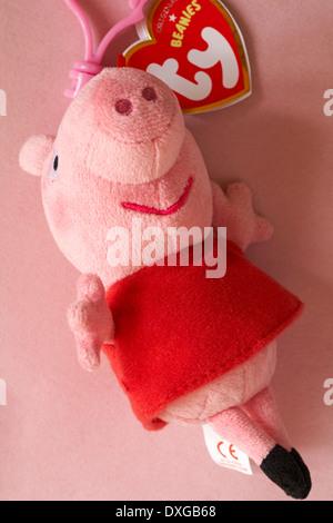 Peppa Pig ty original beanies beanie set on pink background - Stock Photo