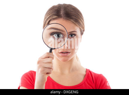 Beautiful woman looking through a magnifying glass, isolated on white - Stock Photo