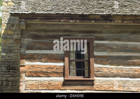 Window of a log home in Spring Mill Pioneer Village, Indiana. Digital photograph - Stock Photo