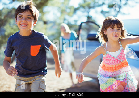 Happy children running from car - Stock Photo