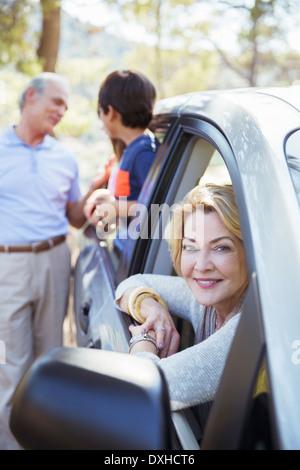 Grandparents and grandchildren inside and outside car