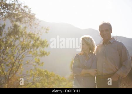 Portrait of happy senior couple outdoors - Stock Photo