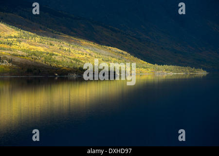a late shaft of sunlight on Tutshi Lake, British Columbia, Canada - Stock Photo