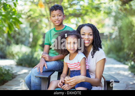 Portrait of smiling mother and children outdoors - Stock Photo