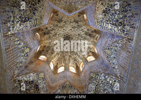 Arabesque Moorish stalactite or morcabe ceiling in the Hall of the Two Sisters, Palacios Nazaries Alhambra. Granada - Stock Photo