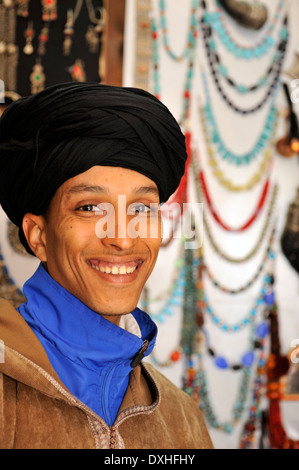 Portrait of younger Moroccan man wearing turban - Stock Photo