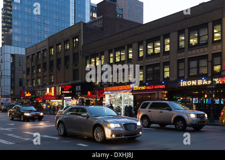 Traffic and Street Scene at Dusk, 8th Avenue Near Times Square, NYC, USA - Stock Photo