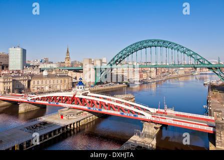 Newcastle upon Tyne city skyline with Tyne bridge and swing bridge over River Tyne Tyne and Wear Tyneside England - Stock Photo