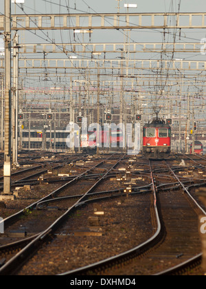 A train of the Swiss national railroad company SBB is approaching Zurich main station. - Stock Photo