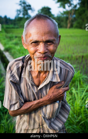 Old local man smiles in Senaru, Lombok, Indonesia - Stock Photo