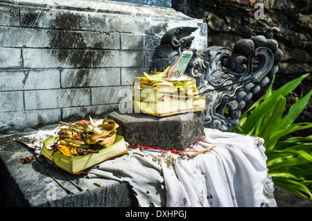 Hindu offering in Pura Batu Bolong Temple, south of Senggigi, Lombok, Indonesia, Southeast Asia, Asia - Stock Photo