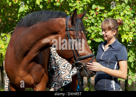 Beautiful young girl and horse - Stock Photo