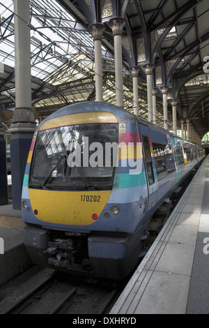National Express train at platform Liverpool Street Station, London, England - Stock Photo