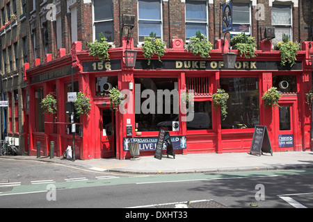 Bright red painted traditional public house, The Duke of York pub, 156 Clerkenwell Road, Camden, London, England - Stock Photo