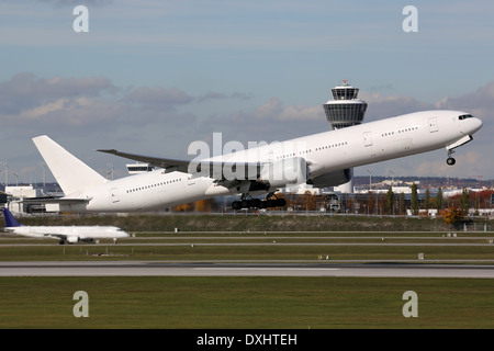 An airplane is taking off at Munich airport - Stock Photo