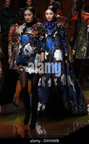 Beijing, China. 26th Mar, 2014. Models present cold-proof garments designed by Zhu Lin during a fashion show at - Stock Photo