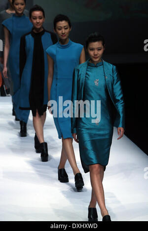 Beijing, China. 26th Mar, 2014. Models present creations designed by Lian Huiqing during a fashion show at Beijing - Stock Photo