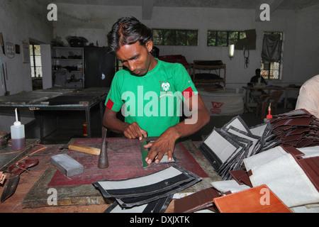 Artisan making leather goods in urban village, District Hazaribaug, Jharkhand, India - Stock Photo