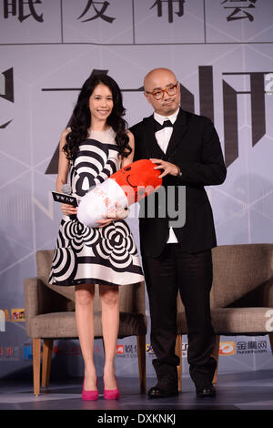 Beijing, China. 26th Mar, 2014. Actor Xu Zheng and actress Karen Mok at press conference of film The Great Hypnotist - Stock Photo