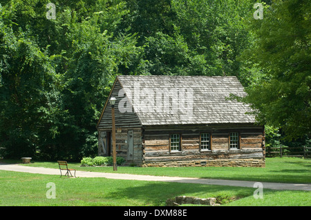 Log meeting-house (restored) in Spring Mill Pioneer Village, Indiana. Digital photograph - Stock Photo