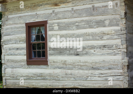 Log home window in Spring Mill Pioneer Village, Indiana. Digital photograph - Stock Photo