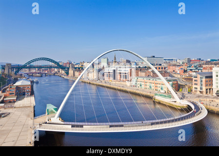 gateshead Millennium bridge and Tyne bridge over River Tyne Newcastle upon Tyne skyline Tyne and Wear England UK - Stock Photo